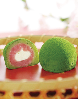 Cherry-flavored, Green Powdered Tea Daifuku (Soft rice cake stuffed with sweetened bean jam, covered with green powdered tea and cherry leaf)